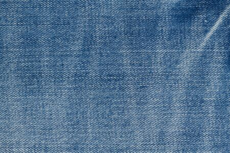 Blue jeans denim material background with copy space for message or use as a texture