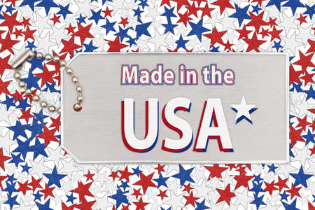 Made in the USA word message on silver ID tag with chain on red, white and blue stars paper Stok Fotoğraf