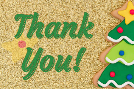 Thank you word message with gingerbread Christmas tree on gold glitter Zdjęcie Seryjne