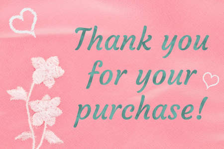 Thank you word message on pink wrinkled textured material with flower