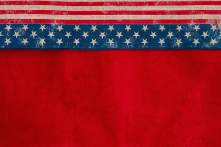 Retro USA stars and stripes burlap ribbon on red fabric background with copy space for your American message