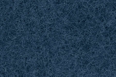 Blue textured scratch pad material background with copy space for message or use as a texture