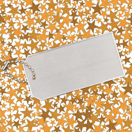 Silver ID tag with chain on gold stars paper with copy space