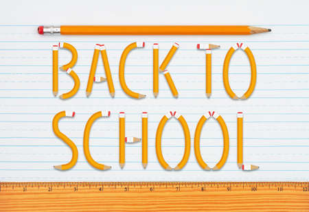 Back to School word message on retro lined school paper with a pencil and ruler