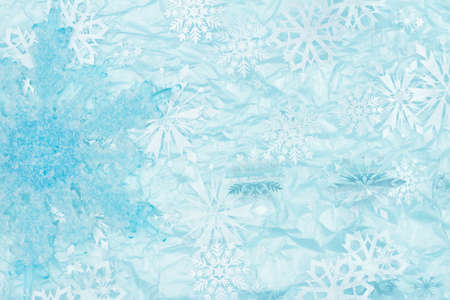 Blue snowflake distressed grunge textured material background with copy space for message or use as a texture