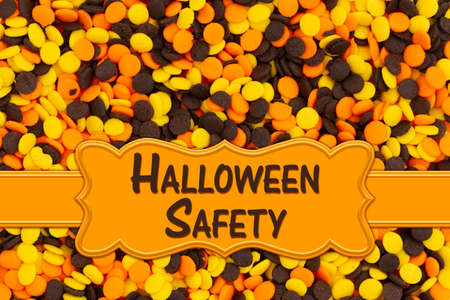 Halloween Safety word message with yellow, orange and brown candy Stock Photo