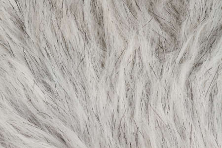 Gray fake fur textured material background with copy space for message or use as a texture
