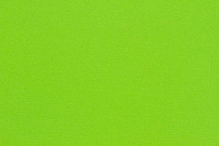 Lime green textured cardstock paper closeup background with copy space for message or use as a texture
