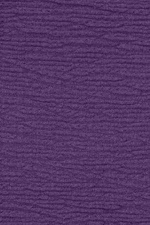Purple polyester textured fabric closeup background with copy space for message or use as a texture