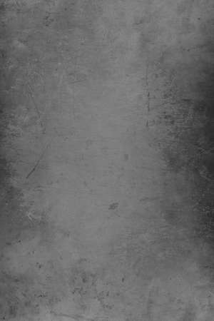 Silver distressed metal grunge textured material background with copy space for message or use as a texture