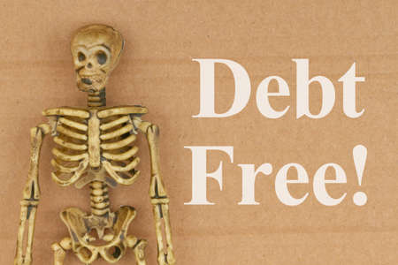 Debt Free word message with skeleton on brown textured cardboard for a humorous message about your finances Stock Photo