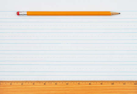 Retro lined school paper with a pencil and ruler background with copy space for your school message