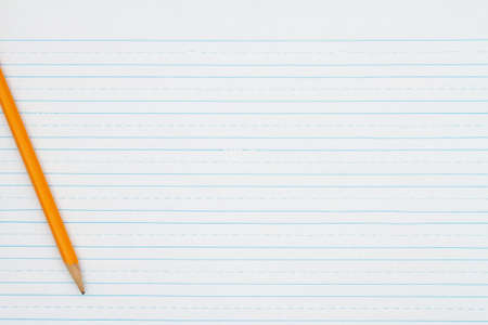 Retro lined school paper with a pencil background with copy space for your school message Stock Photo