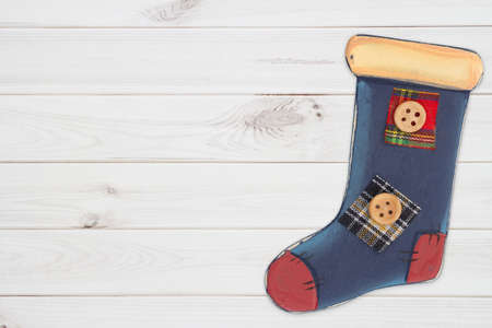 Christmas background with retro Christmas stocking on distressed whitewash with copy space for Christmas or holiday message