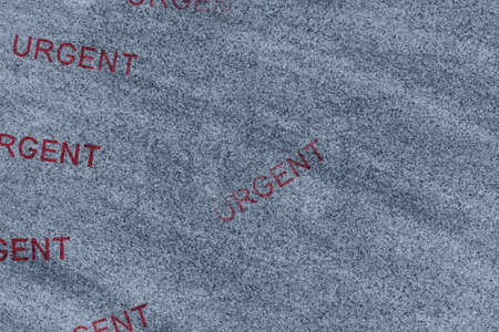 Urgent word message stamp on a weathered stone with copy space