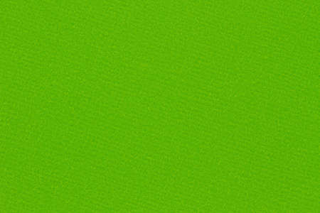 Green felt textured material closeup background with copy space for message or use as a texture