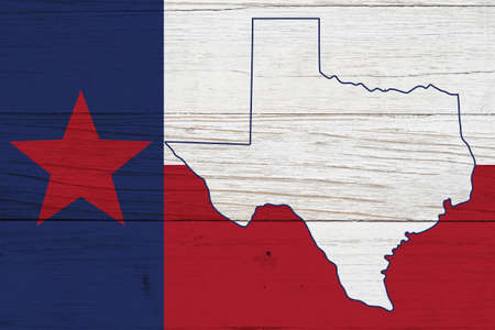 Texas state flag with the state map over weathered wood with copy space for your Texan message