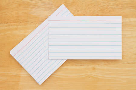 Retro white paper index cards on wood desk with copy space for your message