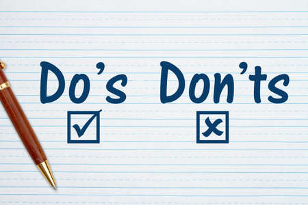 Do's and Don'ts message on retro lined school paper with a pen