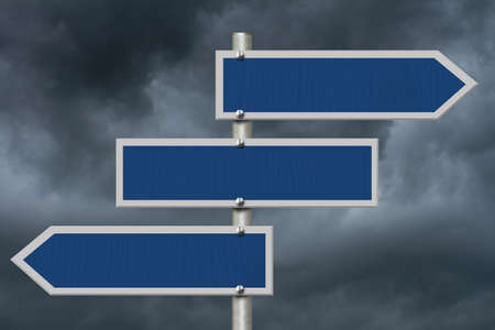 Three blank blue highway road sign with stormy sky with copy space for your message 版權商用圖片