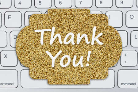 Thank You message on a gray glitter sign on black keyboard for your online sales 版權商用圖片