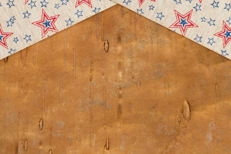 Retro American patriotic background with USA flag stars ribbon on wood with copy space for your patriotic message 版權商用圖片