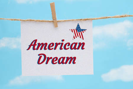 American Dream white greeting card with USA flag star over hanging clear blue sky 版權商用圖片