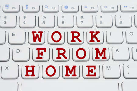 Work from Home on the internet message in red on a gray keyboard