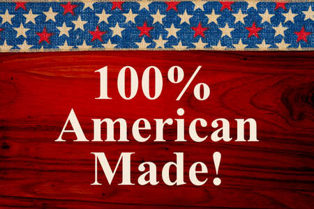 100% American Made message with red, white and blue USA stars banner on red wood 版權商用圖片