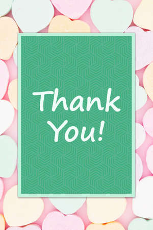 Thank you green greeting card over candy hearts