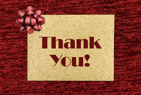 Thank you gold glitter greeting card on red with a bow