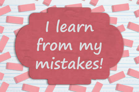 I learn from my mistakes sign on pink eraser on ruled paper