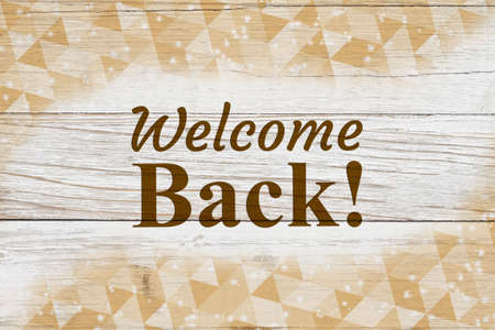 Welcome Back message with gold triangles swirl on weathered whitewash wood