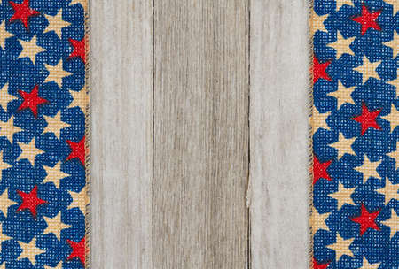 Retro American patriotic background with grunge USA stars banner on weathered wood with copy space for your patriotic message
