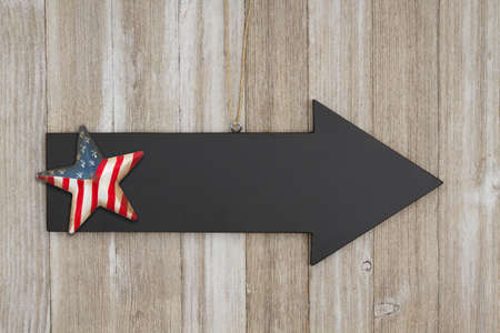 Retro American patriotic background with arrow sign and grunge USA flag stars on weathered wood