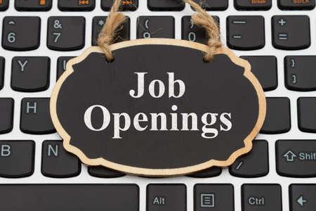 Job Openings message on chalkboard on a black and silver keyboard 版權商用圖片