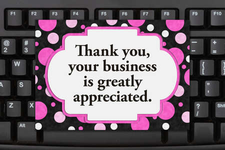 Thank You message on a greeting card on black keyboard for your online sales