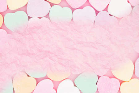 Blank pink paper over candy hearts
