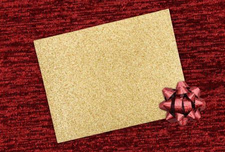 Blank gold glitter greeting card with red bow