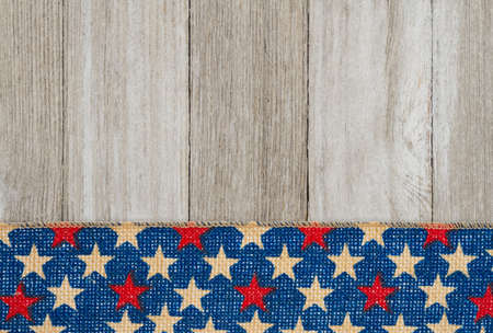 Retro American patriotic with grunge USA stars banner on weathered wood