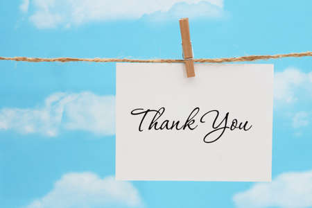 Thank you white greeting card over hanging clear blue sky 版權商用圖片