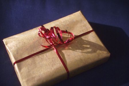 Package tied with ribbon Stock Photo