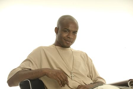 Young black man sitting reading magazines Stock Photo