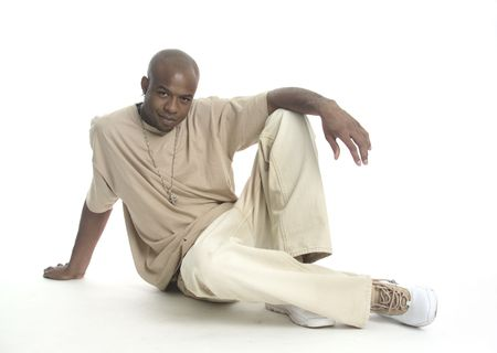 Attractive young African American man sitting on the floor