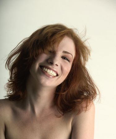 red head: Tousle haired laughing red head Stock Photo