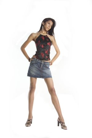Young woman wearing a short skirt to show her very long legs Stock Photo