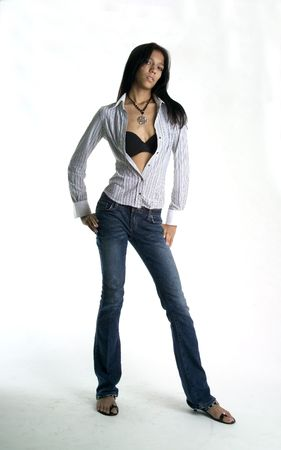 Young woman in jeans and shirt photo