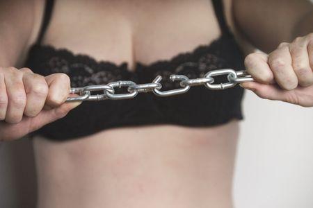 woman in her underwear breaking a chain Stock Photo - 250880