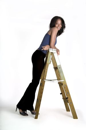 long pants: Attractive black girl leaning on a ladder