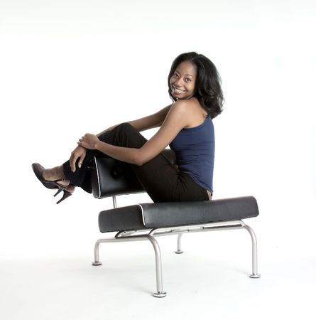 Happy African American woman with her legs over the back of a chair Stock Photo - 250856